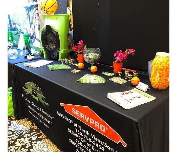 Table with marketing supplies at a trade show.